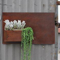 Rusty steel wall pocket planter!