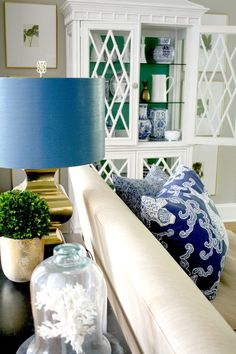 Living Room decor ideas - A Classic Palette: Blue, Green & White living room with decorative storage.