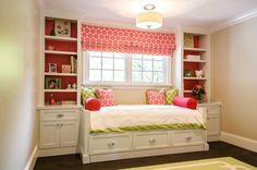 Fantastic pink and green girl's bedroom with built-in cabinetry and daybed with trundle ...