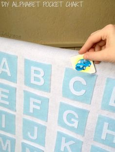 See how easy it is to make your own Alphabet Pocket Chart! You can use it on the wall, on an easel or even as a baby gate cover!