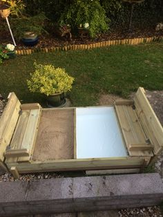 Sandpit and paddling pool with folding seats