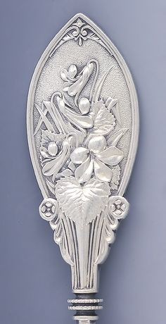 Pattern Detail: Whiting aesthetic period sterling silver sugar spoon, with shell form bowl and unusual floral motif, c1870
