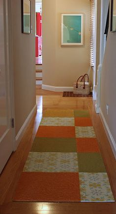 Not my favorite colors, but I love the idea for a quilted carpet runner!