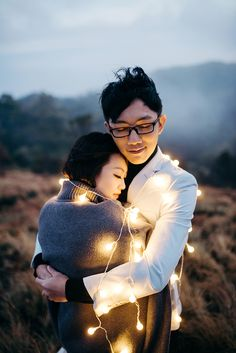 Epic nature pre wedding photoshoot in front of Mount Bromo volcano with pretty fairy lights // When Wiwi and Shuyi were thinking about where to shoot their pre-wedding photos, Mount Bromo seemed like the most natural choice. Fixer Photography captured the fun-loving couple perfectly in the romantic early morning mist atop the volcano in Surabaya, Indonesia.