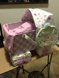 Baby Carriage diaper cake for Baby shower.