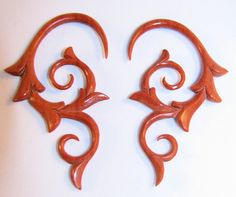 """Avaia Artistic Jewelry  - Eros red sabo wood, hand carved, hanging ear gauges - 12g - 1/2"""" spiral plugs for stretched piercings, $25.99 (http://www.avaiaartisticjewelry.com/eros-red-sabo-wood-hand-carved-hanging-ear-gauges-12g-1-2-spiral-plugs-for-stretched-piercings/)"""