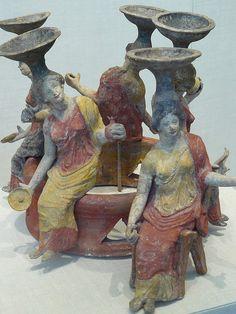 Terracotta group of women seated around a wellhead Greek Tarentine 2nd half of the 4th century BCE