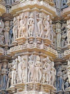 The Erotic Sculptures of the Khajuraho Temples. EROTIC COUPLES ON WALL OF KANDARIYA MAHADEVA TEMPLE, KHAJURAHO Height of sculptures approx. 3 3 (1 m).