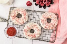 Raspberry Vanilla Baked Donuts. These quick and easy baked donuts are downright delicious. With pops of fresh, sweet, fruity raspberries; specks of smooth vanilla and a creamy, rich white chocolate glaze these donuts are the reason to get out of bed!