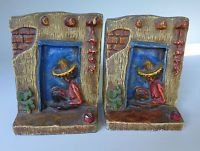 Pair vintage Early California Monterey Mexican 1940 chalk ware relief bookends