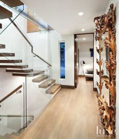 Modern White Floating Staircase with Ornate Mirror