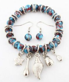 Blue Swirled Beaded Stretch Bracelet with Spacers, Dangling Charms and Matching Drop Earrings JOTW. $0.01. Great Quality Jewelry!. 100% Satisfaction Guaranteed!