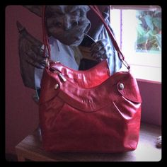 "Sale this weekend!! Ferchi red leather purse cute! Ferchi red leather bag from Spain. Pristine condition. Never used. 13""w x 8"" h x 3.5"" d. 12"" shoulder drop.  Great bag.   I love reasonable offers and I do bundle. So make me an offer. ❤️⭐️ Ferchi Bags Shoulder Bags"
