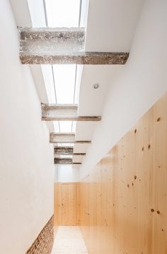 Hallway with skylight and raw concrete beams. Casa Eulalia by Joan ...