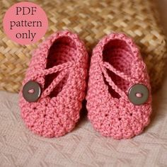 Pretty crochet baby booties with buttons