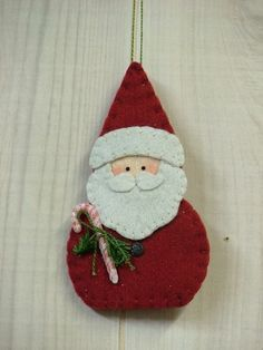 collection of felt ornaments -- some patterns, but not this Santa Felt Christmas Decorations, Christmas Ornaments To Make, Christmas Sewing, Christmas Makes, Noel Christmas, Christmas Projects, Handmade Christmas, Holiday Crafts, Felt Projects