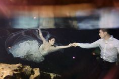 Trash the Dress in a Riviera Maya Cenote, ethereal love with a mermaid bride and her merman groom.  Mexico wedding photographers underwater Del Sol Photography