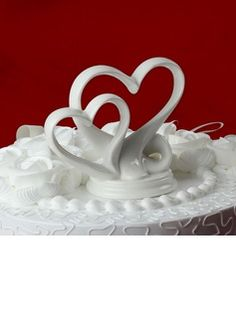 $15.88 - Double Hearts Ceramic Wedding Cake Topper  http://www.dressfirst.com/Double-Hearts-Ceramic-Wedding-Cake-Topper-119030540-g30540