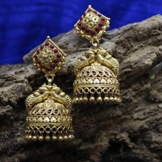 Product Details: Base Material - 92.5 Carat Pure Silver with Gold Plating Technique - Handcrafted Product Type - Temple Jewellery  Design - Jhumka Colour - Red  Length - 2 inch Width - 1.5 inch Care Instructions - Avoid Contact with Perfumes and Water Contact No - +91 8095752326 E-Mail - contactus@madhurya.com   Also available in Pure Gold*  Shipping Worldwide