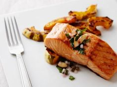 Salmon with Lemon, Capers, and Rosemary Recipe | Giada De Laurentiis | Food Network Oven Baked Salmon, Baked Salmon Recipes, Fish Recipes, Seafood Recipes, Dinner Recipes, Roasted Salmon, Grilled Salmon, Salmon Food, Healthy Weeknight Dinners