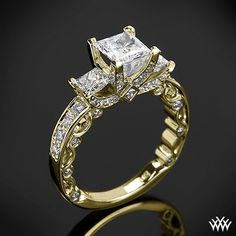 This beautiful 3 Stone Engagement Ring is from the Verragio Paradiso Collection. It features a Lumino Set for both the center and side diamonds and holds 1.00ctw of both Round Brilliant.  I really want this ring :-)