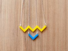 Simple colorful necklace. Reminds me of wario for some reason