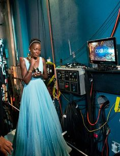 Oscars 2014: Behind the Scenes | ELLE UK Lupito Nyong'o after winning her award