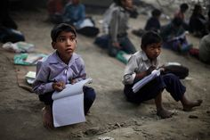 A free school under a bridge in India - The intensity in the eyes of these boys...I wish every student could enjoy and appreciate education like this.