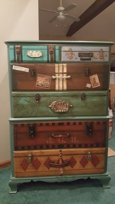 Dresser I painted for Jude's, travel themed bedroom. Suitcase luggage dresser drawers.