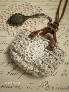 necklace of mini bags and a small hand mirror