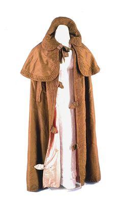 Woman's cloak, brown silk ca. 1830 Origin: Great Britain or America - Brown silk, pink silk lining, wool batting, metal clasps
