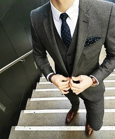 ba549c687 Pairing a grey wool suit and a white classic shirt will create a powerful  and confident