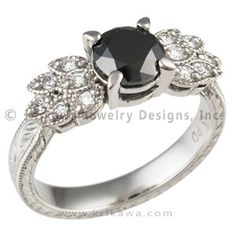 "Antique Leaf Engagement Ring with Black Diamond - An exquisitely hand engraved band tapers into a setting of diamond or sapphire accented ""leaves"" that frame the center diamond. The millegrained edges of the leaves accentuate the vintage feel of this unique engagement ring.  A delicate and feminine hand-engraved leaf pattern adorns the band.  Can you imagine fancy colored diamonds or sapphire accents?  You can even customize this design with two-tone precious metals!  Contac…"