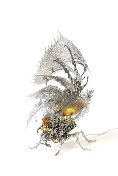 Gorgeous Metal Insect Sculptures That Glow and Flap Their Wings