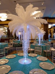 Crystal chandelier light up centerpiece with feathers at the top for a Wedding in Boston MA | Flickr - Photo Sharing!