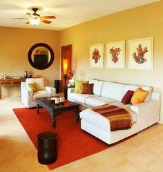 Ter uma sala elegante nem sempre custa caro. É só saber escolher um bom tapete, almofadas e manta para sofá. Voilá! | Foto: www.decoracao.com