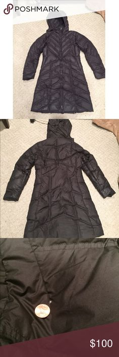 Patagonia Parka Patagonia parka with down insulation. Long black & incredibly warm! I've had this coat for two Michigan winters, it still looks great but does have 3 minor holes biggest one is shown in second photo on back of jacket & is very small in comparison to the penny pictured. Patagonia Jackets & Coats Puffers
