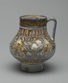 Kashan. Beaker, 13th century. Ceramic; fritware, painted in luster and blue over an opaque white glaze, 6 3/4 x 3 5/16 in. (17.1 x 8.4 cm). Brooklyn Museum, Museum Expedition 1913-1914, Museum Collection Fund, by exchange, 2009.41. Creative Commons-BY (Photo: Brooklyn Museum, 2009.41_PS2.jpg)