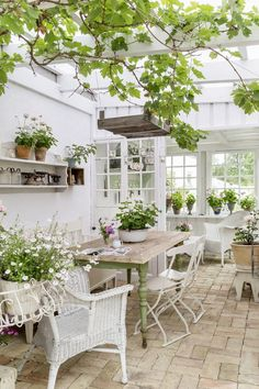 Rustic furniture complements an antique brick floor perfectly in this bright and airy garden room. Outdoor Rooms, Outdoor Gardens, Outdoor Living, Outdoor Furniture Sets, Outdoor Decor, Rustic Furniture, Antique Furniture, Conservatory Ideas Interior Decor, Conservatory Interiors