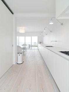 bulthaup kitchen - all kept in white with Douglas 30 cm wide planks: