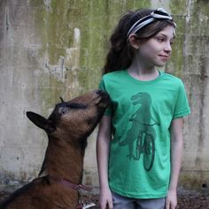 Our goats photo bombed our last photoshoot for our kids line.
