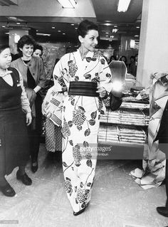 Audrey Hepburn tries a yukata, summer kimono and poses at a department store in April 1983 in Kyoto, Japan.