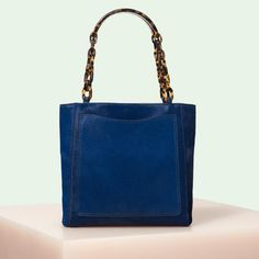 d99f45d96510 Edie Parker designer handbag Mini Tote in Navy Haircalf with acrylic  tortoise top handle chain.