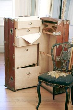 Antique steamer trunk / gun locker?  rifles on the right-cleaning supplies, handguns and ammo on the left.