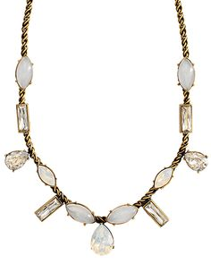 Paired with our Crystal Clear Earrings, this show-stopping Brass-based Necklace with Moonstone and Swarovski crystals make this  a great choice for adding sparkle to your special day!