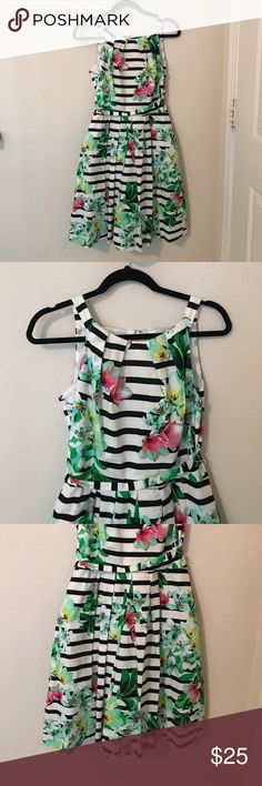 Leslie Fay floral + striped dress sz 8 Floral with black and white stripes dress. I am 5 ' 3 and it hits just below the knee. Lined and has a petticoat to add lift to the skirt. Designer Leslie Fay. Leslie Fay Dresses Midi