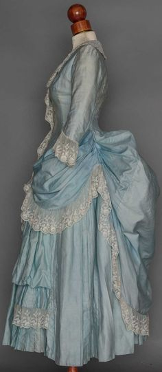 TWO YOUNG LADIES' BUSTLE DRESSES, 1880