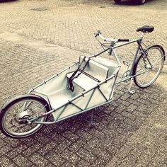 Not just another cool cargo bike - the bench inside puts this bike over the top for me.