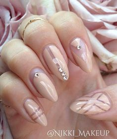 Wonderful looking nude nail art for long nails. You can add more designs when you're working on nude nail polish with long nails. Add on silver beads on top as well as geometric shapes on the polish.