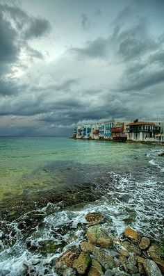 A moody moment.. Little Venice - Mykonos Island, Greece | Flickr - Photo by Vasilis Tsikkinis